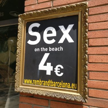 Board in front of a restaurant in Barcelona